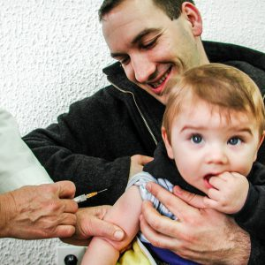 Bosnian father and child during immunization